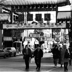 People walk past the entrance to Chinatown in 1994.   Sun-Times Archives