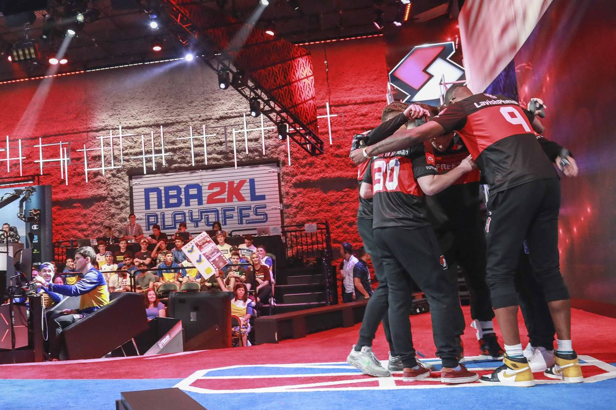 Members of Blazers Gaming, an NBA 2k League professional esports team, huddle before a match against Warriors Gaming Squad.