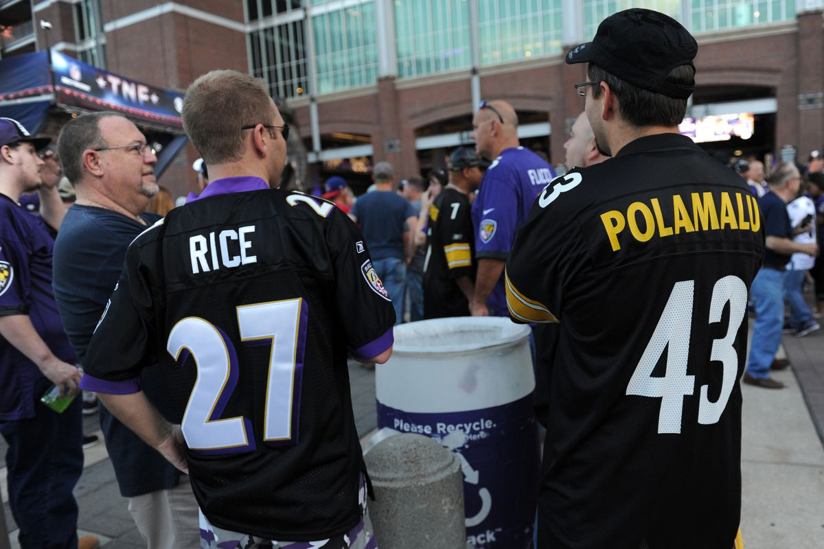 Look at this douchebag wearing a Ray Rice jersey to the game tonight
