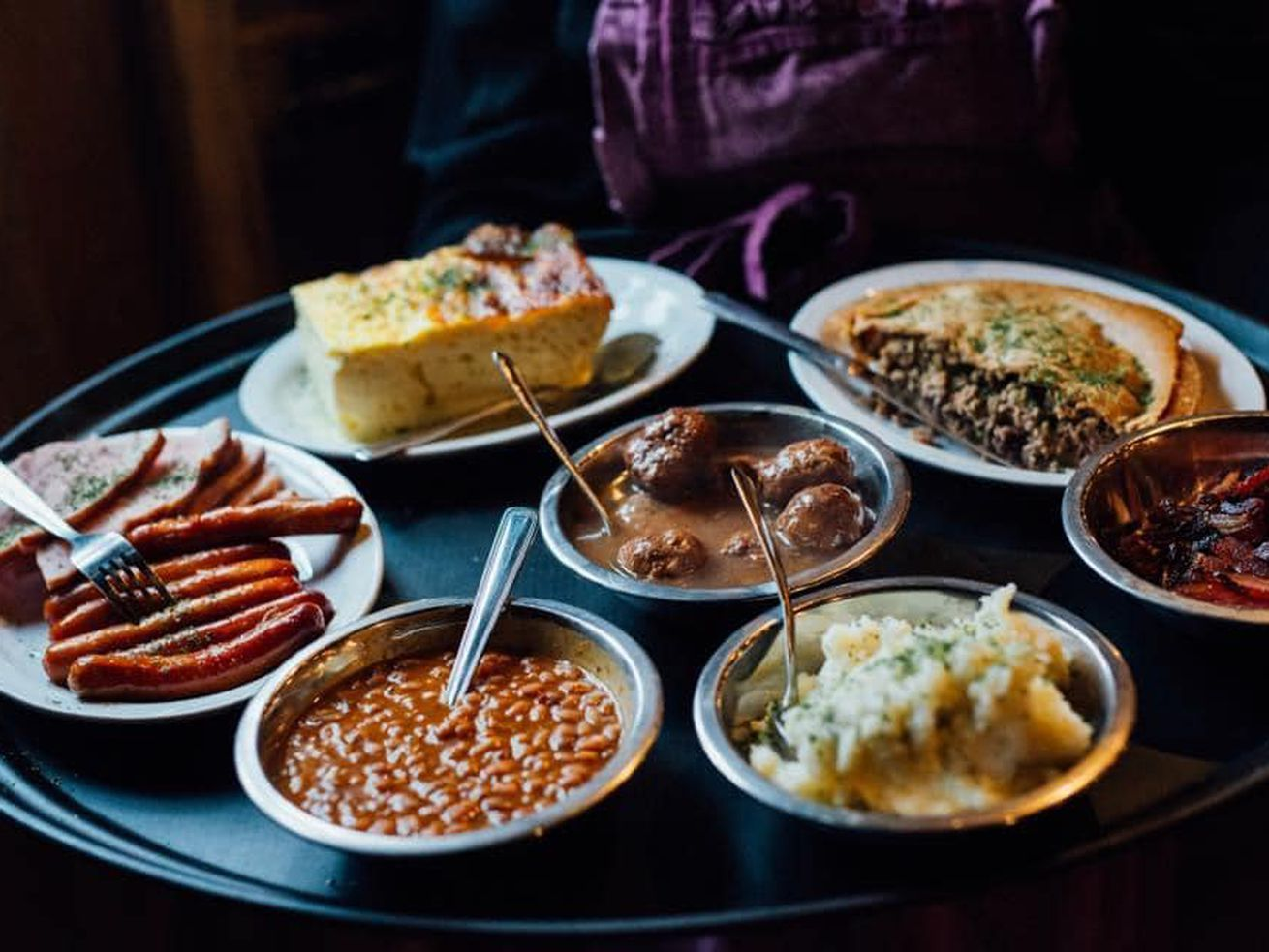spread of traditional sugar shack dishes like beans, omelette, meat pie