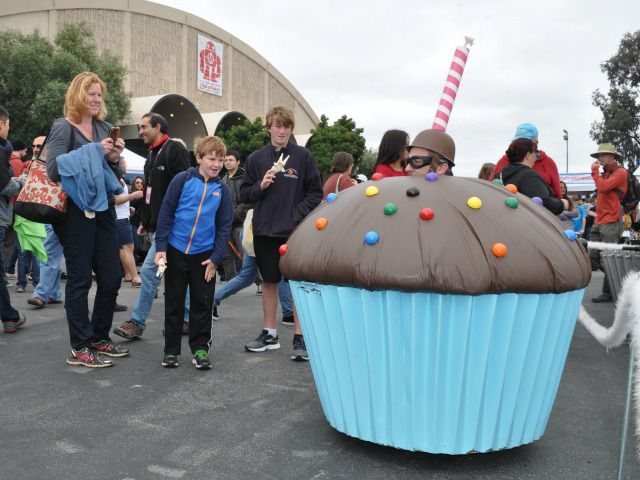 A man rode around Maker Faire in this cupcake car with a fake candle attached to his helmet.