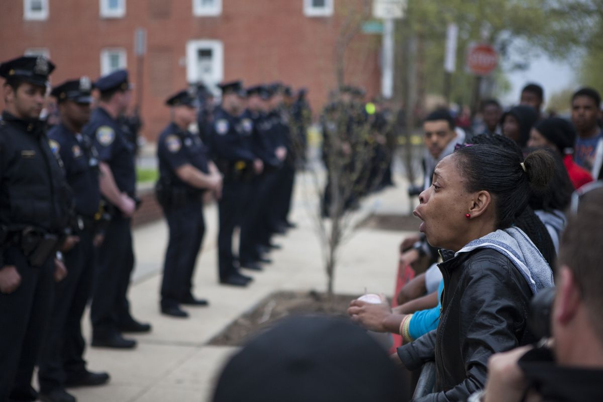 Demonstrators protest the lack of answers over Freddie Gray's death.