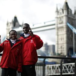 The winners of the 2011 men's and women's London Marathon races Kenya's Emmanuel Mutai, right, and Mary Keitany pose for photographers during a media event by Tower Bridge in London, Tuesday, April 17, 2012. The 2012 London Marathon takes place on Sunday.