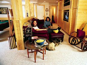 <p>An unfinished basement became a comfortable gathering place in this Massachusetts home. Sherri Martinelli, here with daughter Cambria, set out to create a haven for teens.</p>