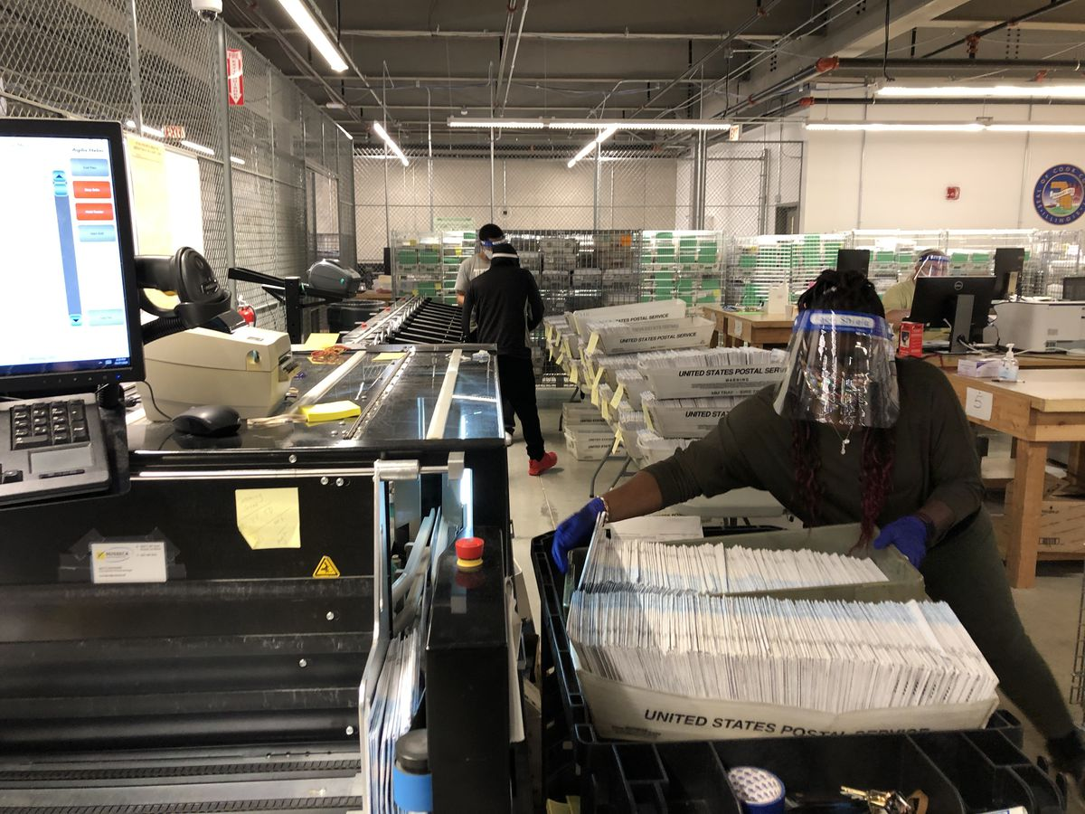 Sorting and scanning ballots at the Cook County Elections Operations Center in Cicero Tuesday, Oct. 27, 2020.