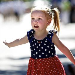 Jazmin Pearl, age four of Twin Falls, Idaho watches as the horses walk past as she and other spectators watch the floats, horses and celebrities participate in the Days of '47 Parade in Salt Lake City Saturday.