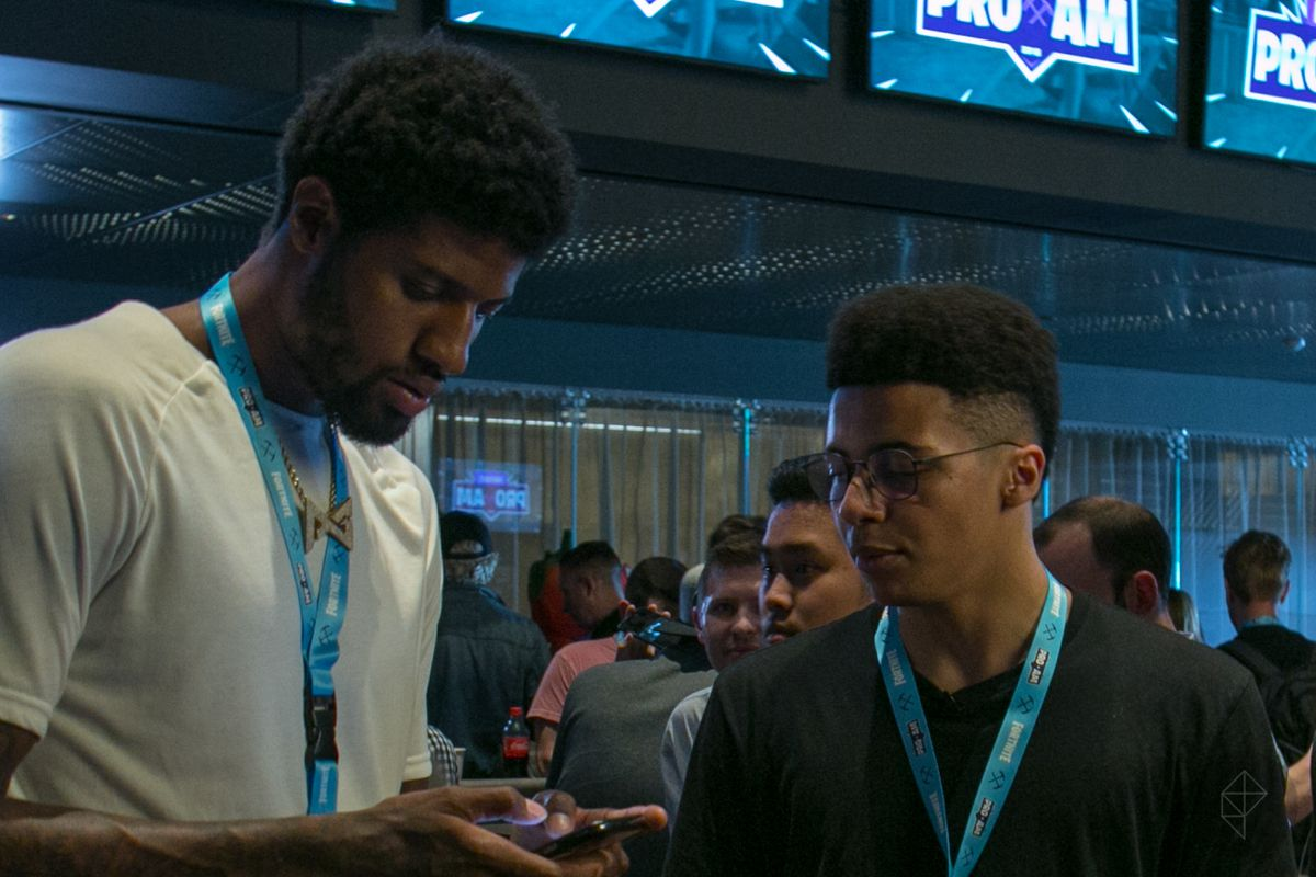 Paul George and Myth exchange numbers backstage before the Fortnite Pro-Am tournament
