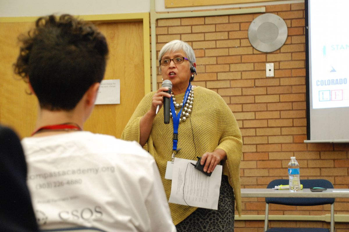 Board member Rosemary Rodriguez speaks at Abraham Lincoln High  (Chalkbeat file)