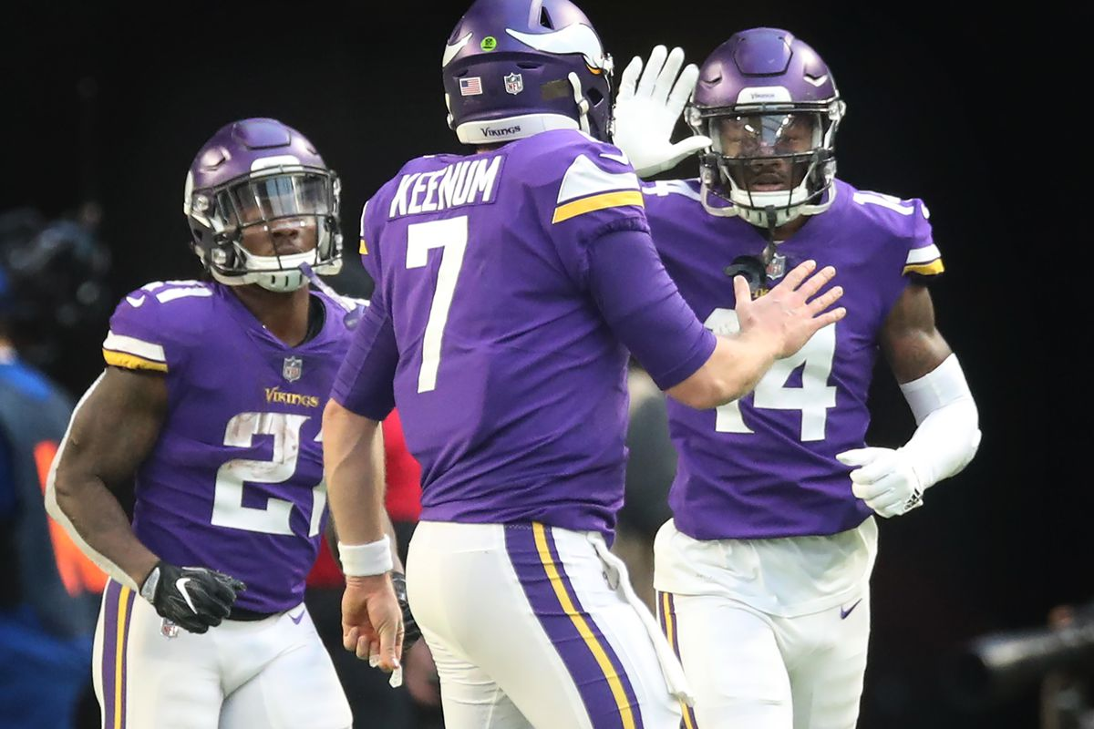 Minnesota Vikings quarterback Case Keenum (7) left celebrated Minnesota Vikings wide receiver Stefon Diggs (14) 15 yard touch down catch in the third quater at U.S. Bank Stadium Sunday December 31, 2017 in Minneapolis, MN.] JERRY HOLT • jerry.holt@s