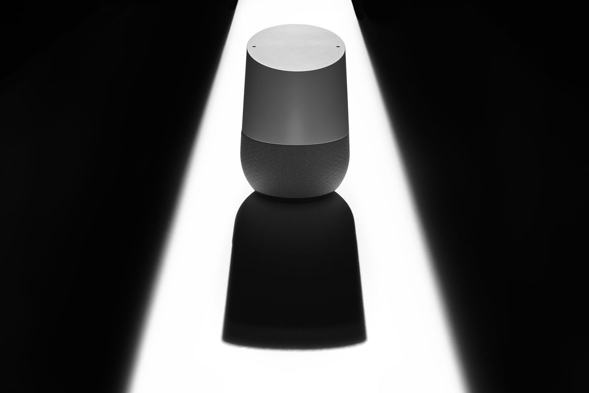 A Google Home smart speaker casting a sinister shadow, to represent issues of privacy and security.