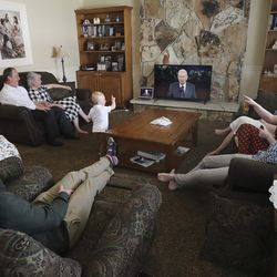 Ron and Wendy Van Tienderen, left, watch the Sunday morning session of the 190th Annual General Conference of The Church of Jesus Christ of Latter-day Saints with their children at their home in Millcreek on Sunday, April 5, 2020.
