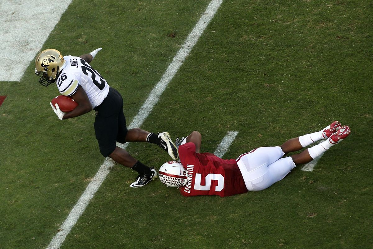 STANFORD, CA - OCTOBER 08:  Tony Jones #26 of the Colorado Buffaloes gets by Devon Carrington #5 of the Stanford Cardinal for a touchdown at Stanford Stadium on October 8, 2011 in Stanford, California.  (Photo by Ezra Shaw/Getty Images)