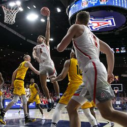 Arizona forward Chase Jeter (4) hooks a shot in over Cal defense during the Arizona-Cal game in McKale Center on February 21 in Tucson, Ariz.