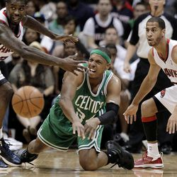 Boston Celtics' Paul Pierce, center, passes the ball as Atlanta Hawks' Marvin Williams, left, and Jannero Pargo defend durign the second quarter of Game 1 of an opening-round NBA basketball playoff series, Sunday, April 29, 2012, in Atlanta.
