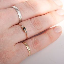 """<a href=""""https://catbirdnyc.com/shop/product.php?productid=19340&cat=491&page=1"""">Black diamond Maleficent ring (middle)</a>, $364"""
