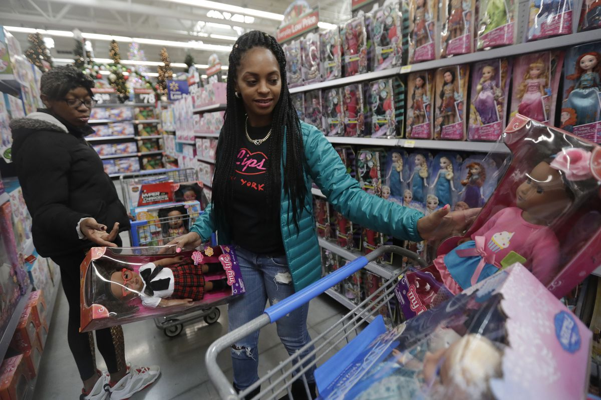 FILE - In this Wednesday, Oct. 26, 2016, file photo, Tiffany Davis, left, and Choisette Hargon, both of Paterson, N.J., shop for toys ahead of Christmas at a Walmart in Teterboro, N.J. As the holiday shopping season officially kicks off Thursday, Nov. 23,