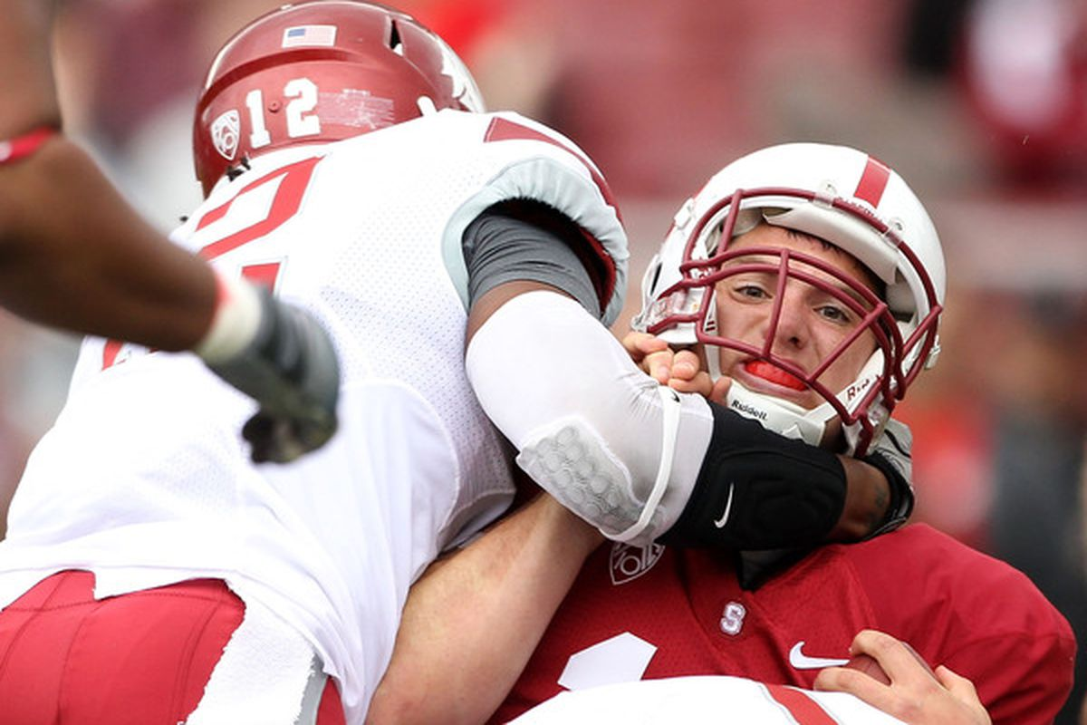 PALO ALTO CA - OCTOBER 23:  Andrew Luck #12 of the Stanford Cardinal is tackled by C.J. Mizell #12 of the Washington State Cougars at Stanford Stadium on October 23 2010 in Palo Alto California.  (Photo by Ezra Shaw/Getty Images)