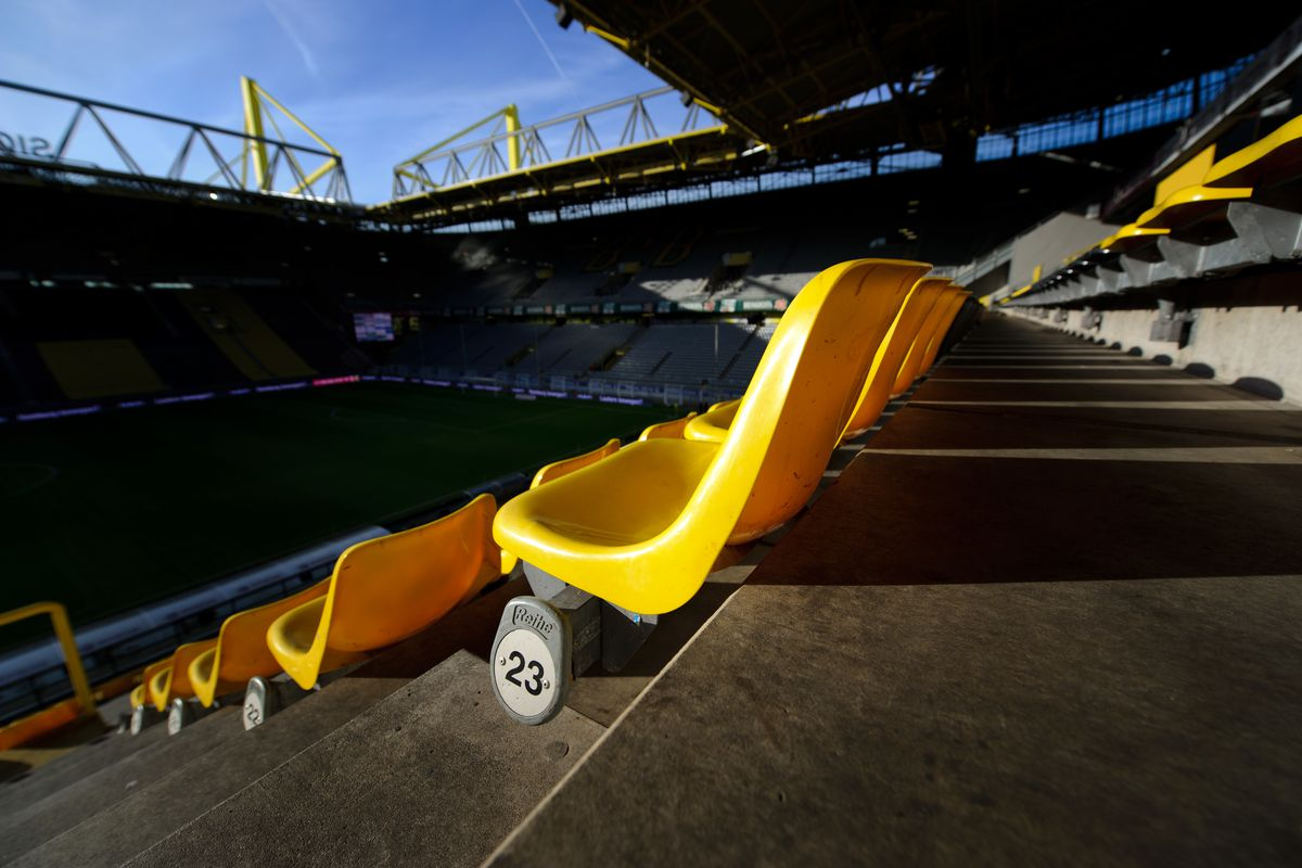 Yellow seats in The Westfalen Stadion also known as Signal Iduna Park the home stadium of Borussia Dormund