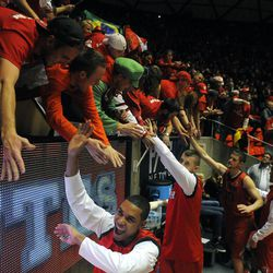 The Utes celebrate their 81-64 win over BYU with the student body during a game at the Jon M. Huntsman Center on Saturday, Dec. 14, 2013.