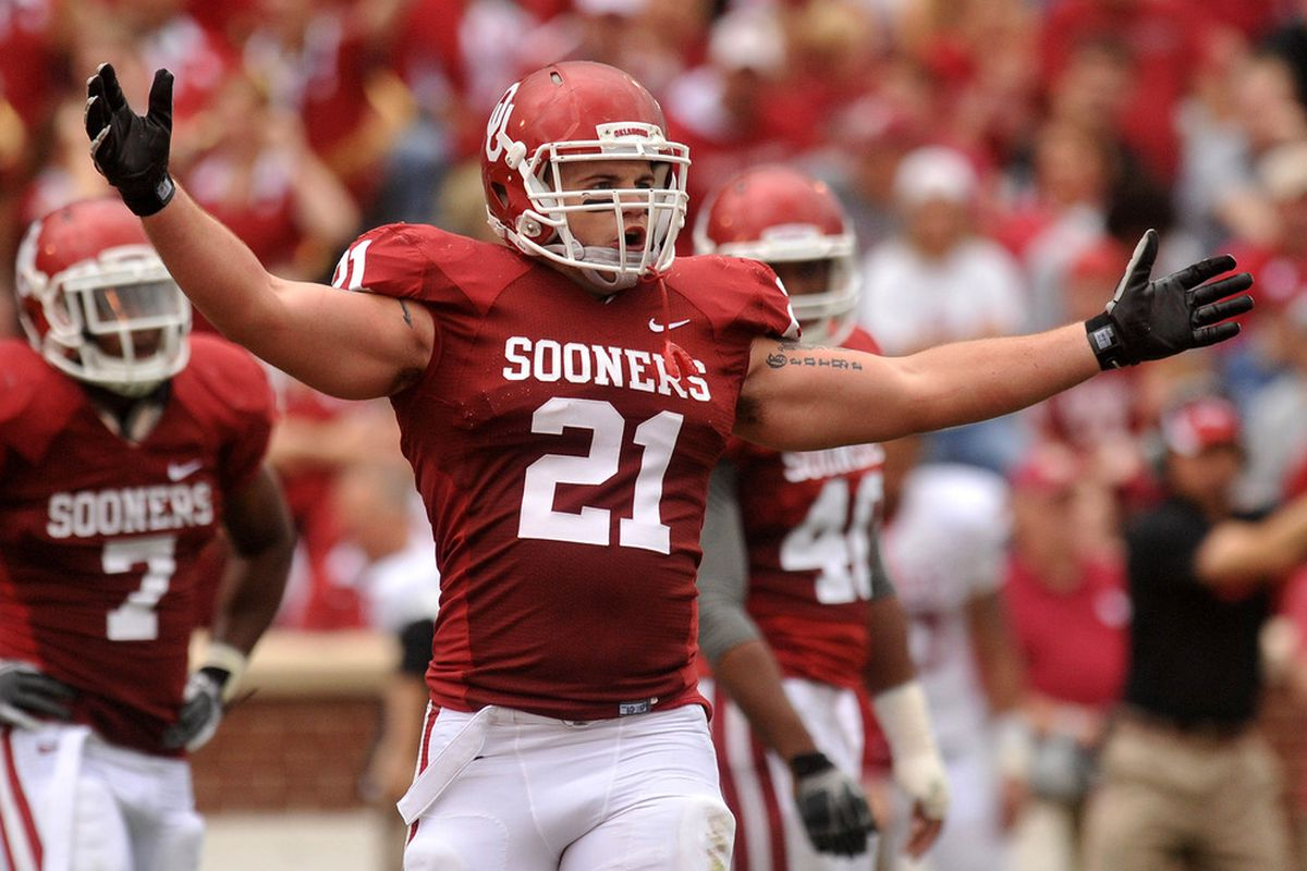 Apr 14, 2012; Norman, OK, USA; Oklahoma Sooners linebacker Tom Wort (21) celebrates a tackle during first half of the Oklahoma spring game at Gaylord Family Oklahoma Memorial Stadium. Mandatory Credit: Mark D. Smith-US PRESSWIRE
