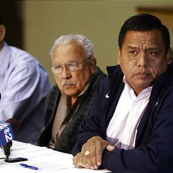 From right, Tony Yapias, Archie Archleta and Mark Alvarez react in favor of the Utah Compact during a press conference at the Centro Civico Mexicano in Salt Lake City Friday, November 12, 2010.