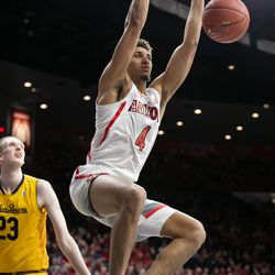 Arizona's Chase Jeter (4) powers home a strong dunk during the Arizona-Cal game in McKale Center on February 21 in Tucson, Ariz.
