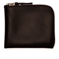 "<strong>Comme Des Garcons</strong> Classic Plain Half-Zip Leather Wallet in Brown, <a href=""http://shop.doverstreetmarket.com/us/comme-des-garcons/wallets/classic-plain/cdg-classic-leather-brown-sa3100"">$96</a>"