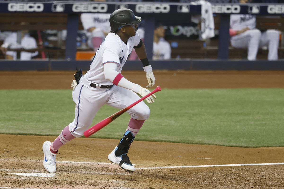 Miami Marlins outfielder Lewis Brinson watches his home run against the Milwaukee Brewers during the seventh inning at loanDepot Park.