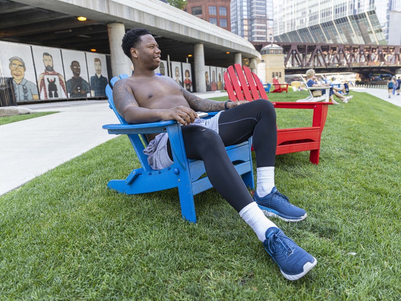 Anthony Brown lounges on the Riverwalk in the loop, Friday, June 11, 2021.