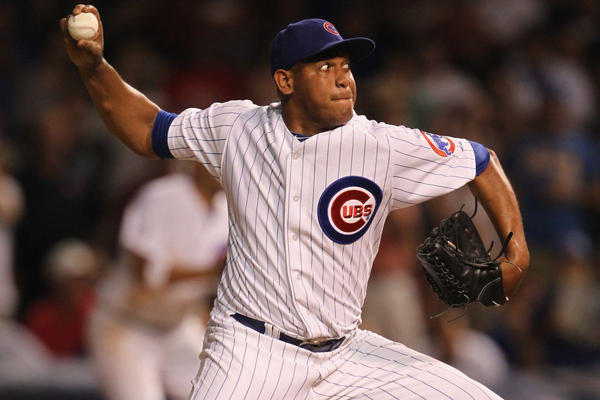 Carlos Marmol of the Chicago Cubs pitches in the 9th inning against the Atlanta Braves on his way to his 30th save of the season at Wrigley Field in Chicago, Illinois. The Cubs defeated the Braves 3-2.  (Photo by Jonathan Daniel/Getty Images)