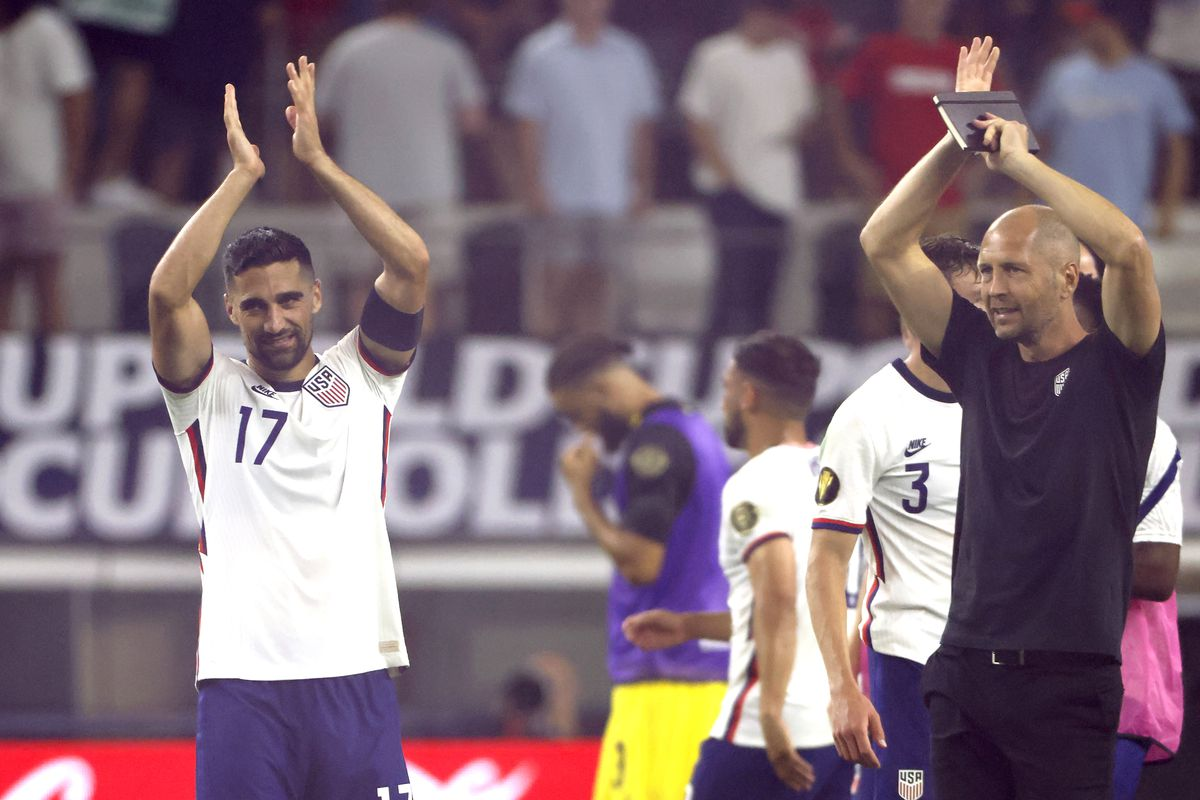 Sebastian Lletget #17 of the United States and head coach Gregg Berhalter celebrate with the team after the United States defeated Jamaica 1-0 in a 2021 CONCACAF Gold Cup Quarterfinals match at AT&T Stadium on July 25, 2021 in Arlington, Texas.