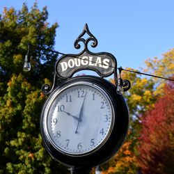 A clock in the quaint business district in the village of Douglas, Mich., is pictured on Tuesday, Oct. 13, 2020.