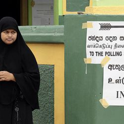 A Sri Lankan Muslim woman stands outside a polling a station after casting her vote at Kattankudi, Sri Lanka, Saturday, Sept. 8, 2012. Sri Lankans voted Saturday in a provincial assembly election seen as a test of whether ethnic minority Tamils still want self-rule or are satisfied with government-led economic development in a region devastated by a quarter-century civil war. As of noon, only small numbers of voters had turned out at polling booths in Batticaloa, one of three districts in Eastern Province.