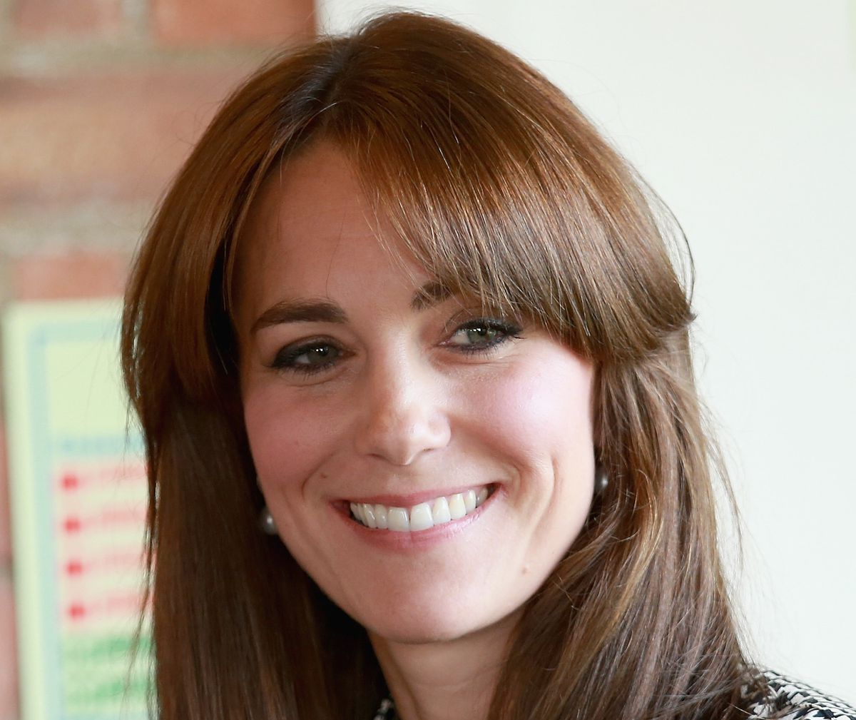 curly haircuts with bangs a closer look at kate middleton s new bangs racked 1668 | GettyImages 488731036.0