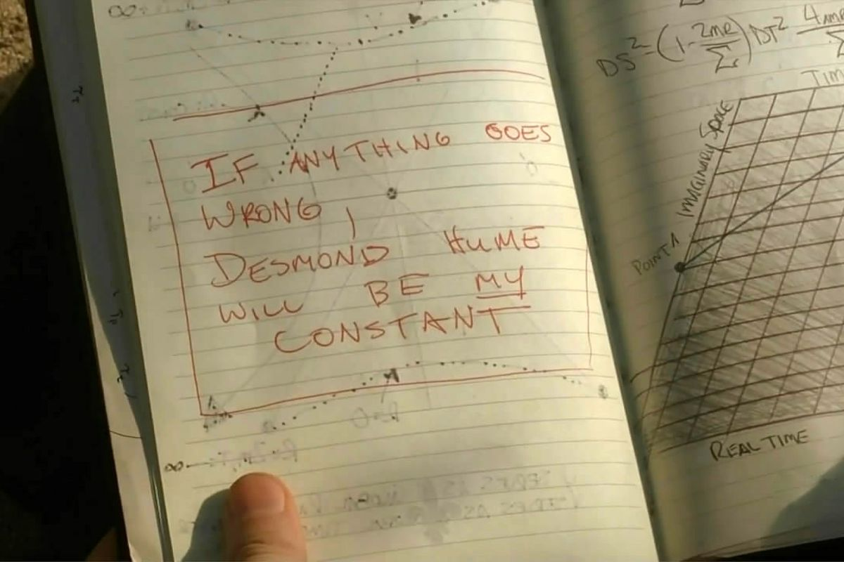 """Still from 'Lost' of a notebook pages that reads, """"If anything goes wrong, Desmond Hume will be my constant"""""""
