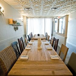 The intimate restaurant features three long communal tables