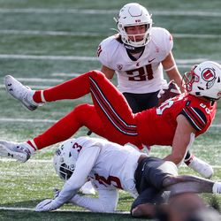 Utah Utes tight end Brant Kuithe (80) is brought down by Washington State Cougars defensive back Daniel Isom (3) during an NCAA football game at Rice-Eccles Stadium in Salt Lake City on Saturday, Dec. 19, 2020.