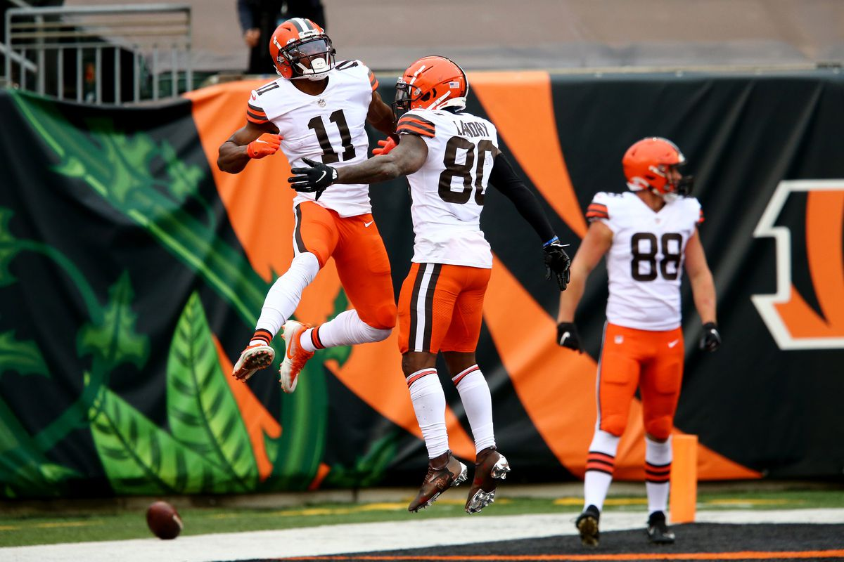 Cleveland Browns wide receiver Donovan Peoples-Jones (11), left, celebrates a go-ahead touchdown catch with Cleveland Browns wide receiver Jarvis Landry (80) during the fourth quarter of a Week 7 NFL football game against the Cincinnati Bengals, Sunday, Oct. 25, 2020, at Paul Brown Stadium in Cincinnati.