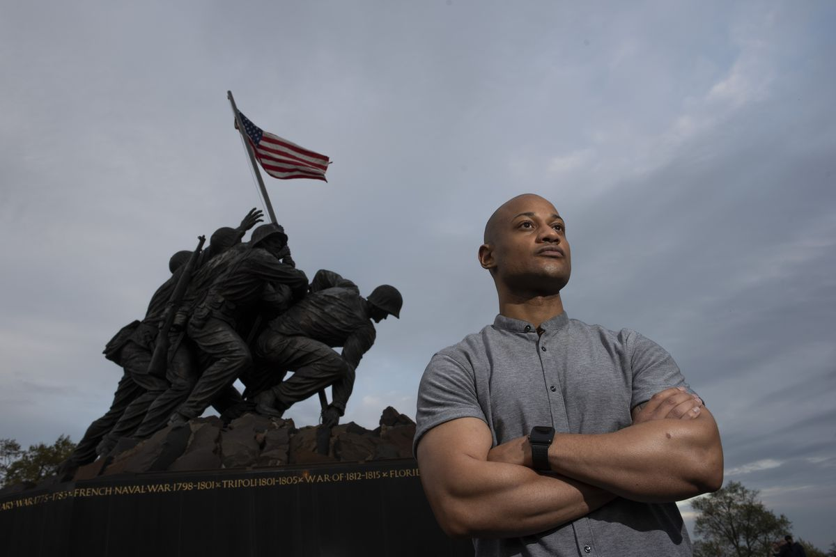 Reserve Marine Maj. Tyrone Collier visits the U.S. Marine Corps War Memorial near his home in Arlington, Va., on Saturday, April 17, 2021.