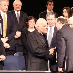 Cardinal Francis George, left, greets LDS apostles Elders M. Russell Ballard and Quentin L. Cook and BYU President Cecil O. Samuelson Tuesday following Cardinal George's remarks at a BYU devotional.
