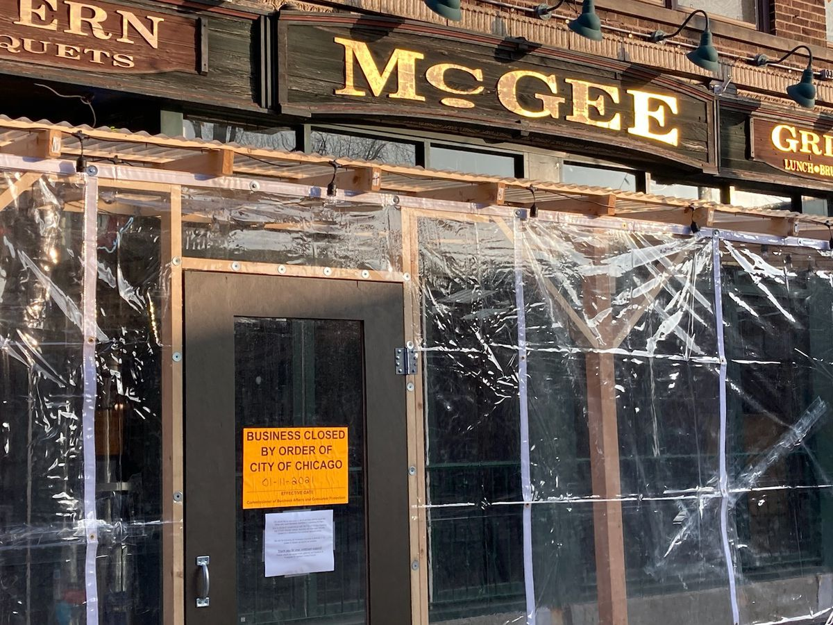 A pub's storefront covered in plastic