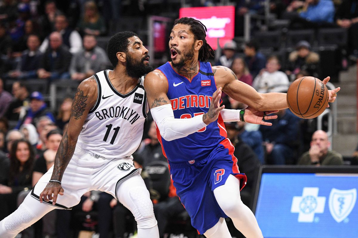 Detroit Pistons guard Derrick Rose drives to the basket against Brooklyn Nets guard Kyrie Irving during the first quarter at Little Caesars Arena.
