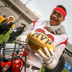 Game MVP defensive back Julian Blackmon (23) shows the MVP trophy after the Zaxby's Heart of Dallas Bowl between the Utah Utes and the West Virginia Mountaineers in Dallas Texas on Tuesday, Dec. 26, 2017.