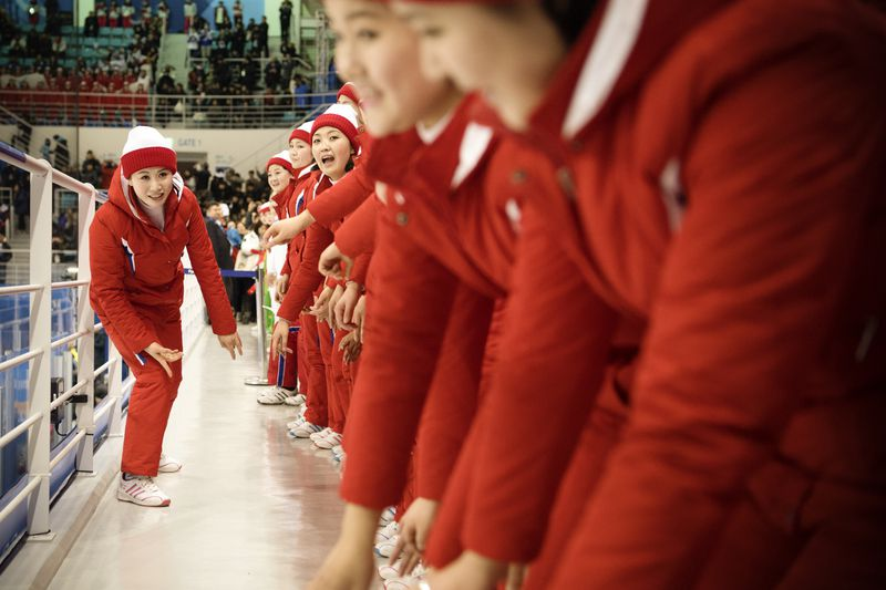 "North Korean cheerleaders perform during the Women""s Ice Hockey Preliminary Round."