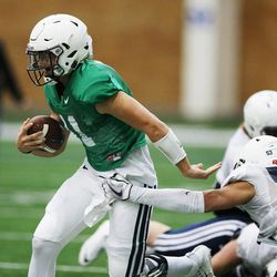 Brigham Young Cougars quarterback Zach Wilson (11) scrambles during an intersquad scrimmage in Provo on Friday, March 23, 2018.