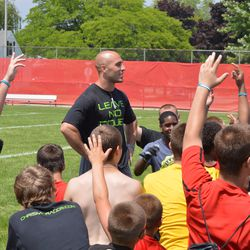 Chris Maragos (middle) talks with camp participants.