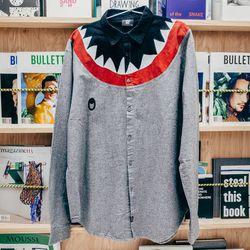 "<b>Lazy Oaf</b> Shark Long Sleeve Shirt, <a href=""http://shop.bullettmedia.com/p/shark-long-sleeve-shirt/"">$122</a>"