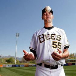 Salt Lake Bees pitcher Loek Van Mil tosses a baseball during media day  in Salt Lake City  Tuesday, April 3, 2012.