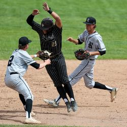 Lone Peak's Keegan Nitta is tagged out by Riverton's Parker Applegate after getting caught in a pickle during a high school baseball game in Highland on Tuesday, June 2, 2020.