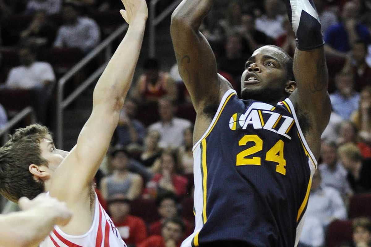 Utah Jazz's Paul Millsap (24) shoots over Houston Rockets' Chandler Parsons in the second half of an NBA basketball game Wednesday, April 11, 2012, in Houston. Utah won 103-91.